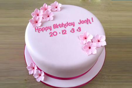 Write a greeting on the pink birthday cake