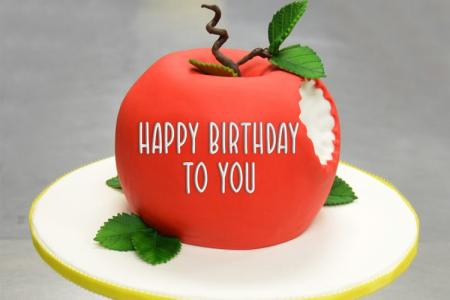 Write a greeting on the apple birthday cake
