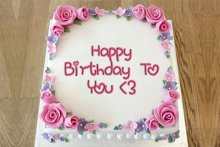 Write a greeting on the birthday cake roses